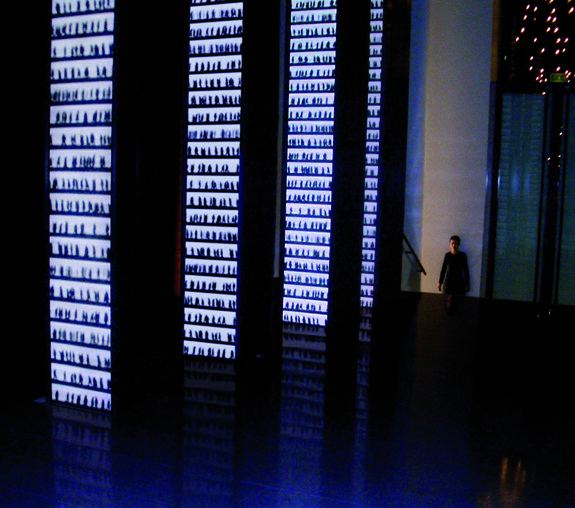 , 2003, Installation view, LVMH Moët Hennessy-­‐ Louis Vuitton, Paris, France. Site-specific video installtion, 6 m high.