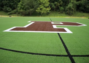Photo: The Kelly Turf Field is lined for varsity-level lacrosse, soccer, and field hockey competition. It reflects the latest research and innovation with regard to optimal athletic performance and injury prevention.