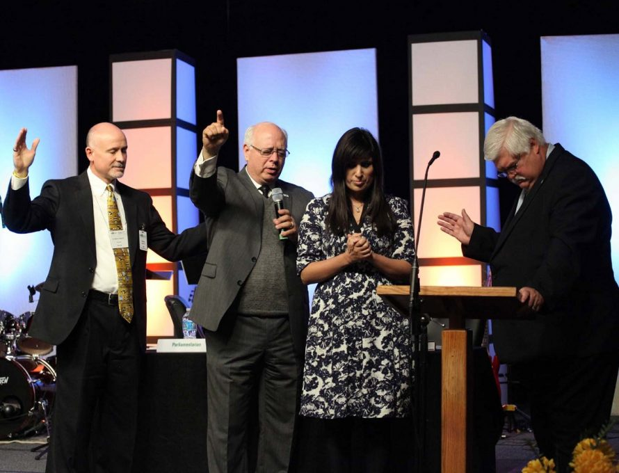KANSAS CITY – Former Missouri Baptist Convention (MBC) President Wesley Hammond, MBC Executive Director John Yeats and Pathway Editor Don Hinkle pray with Naghmeh Abedini for her husband's release after she spoke to messengers at the 2013 Annual Meeting here.  Pathway photo by Bob Greenlee