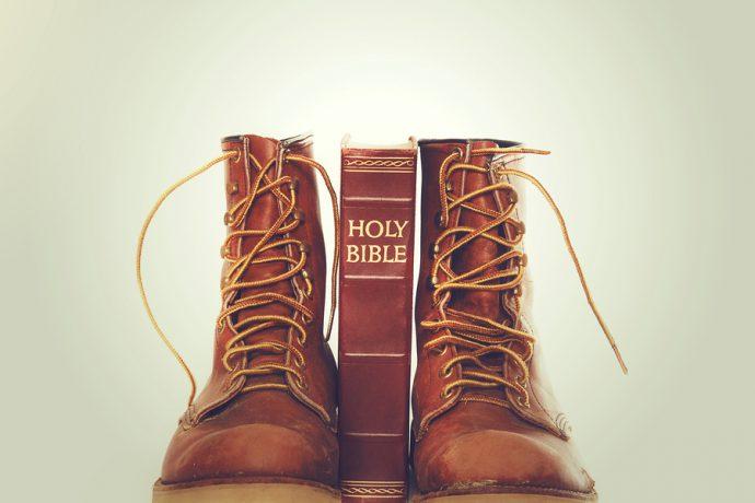 bible standing between work boots