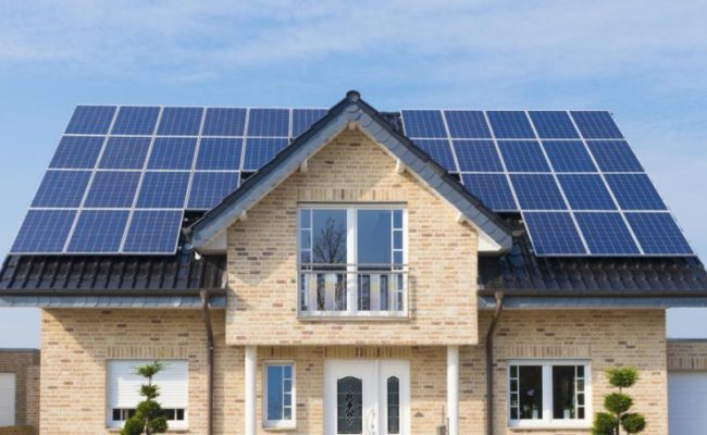 House with solar panels save money