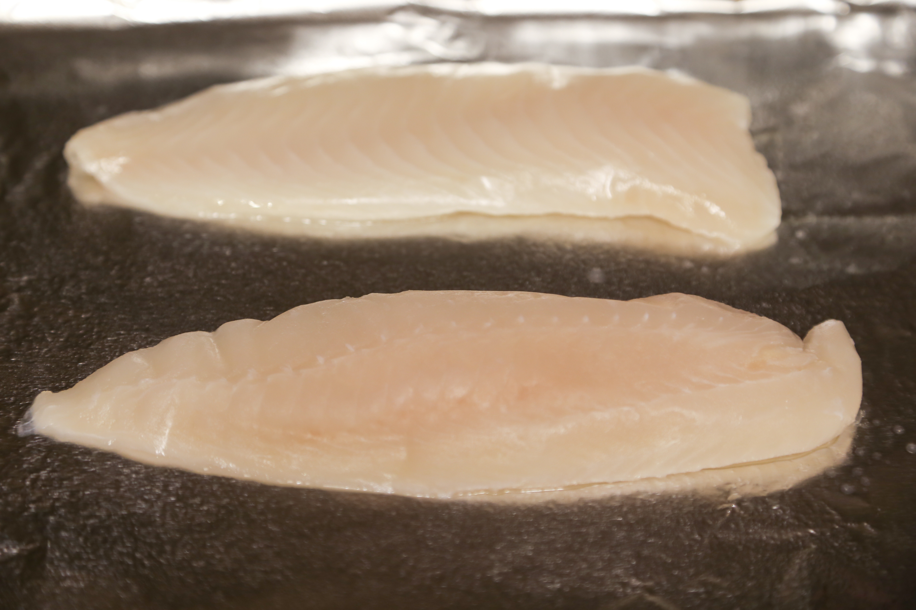 How to cook tilapia fillets in the oven livestrong com for Baking frozen fish