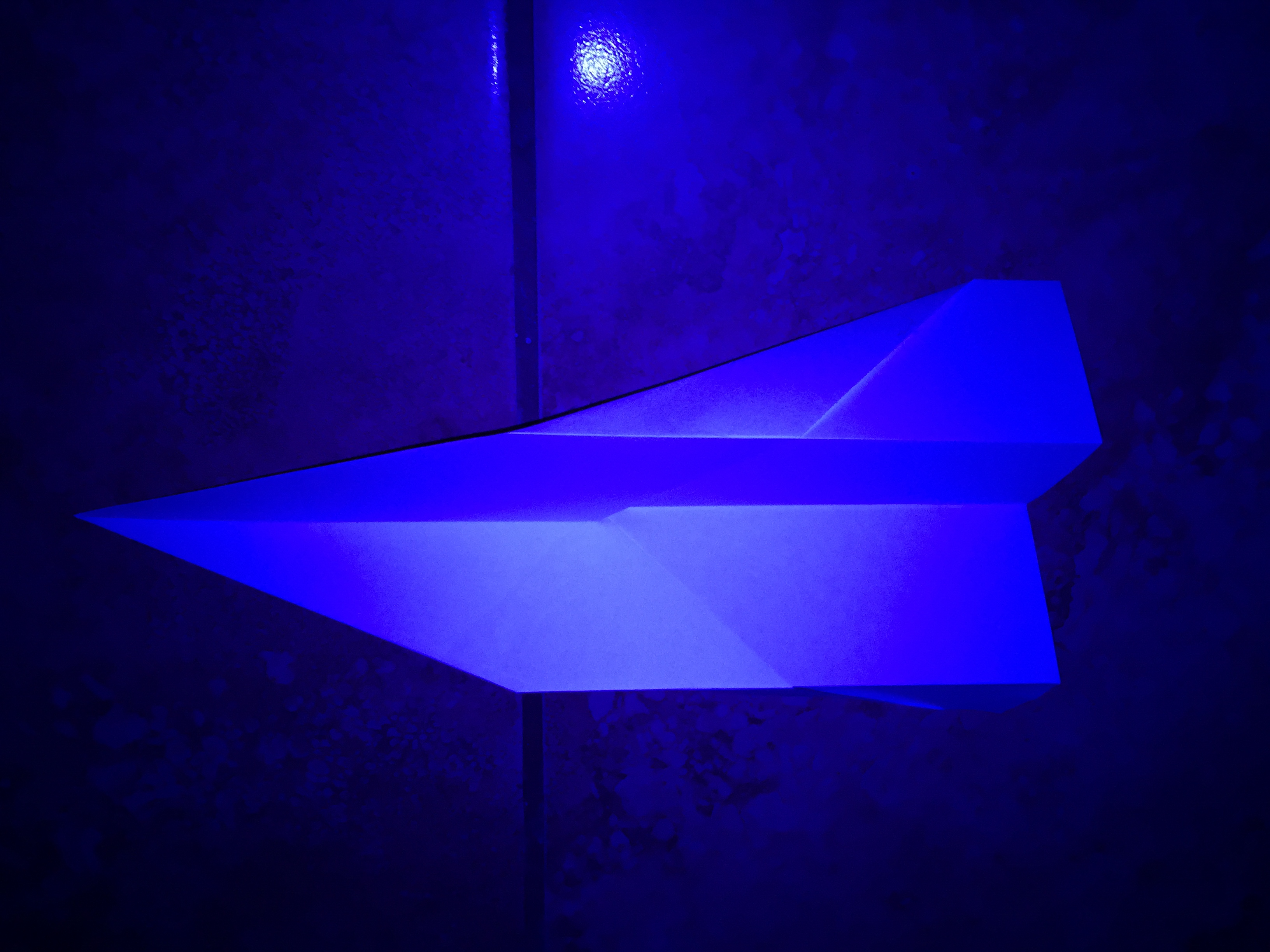 Paper airplane under black light