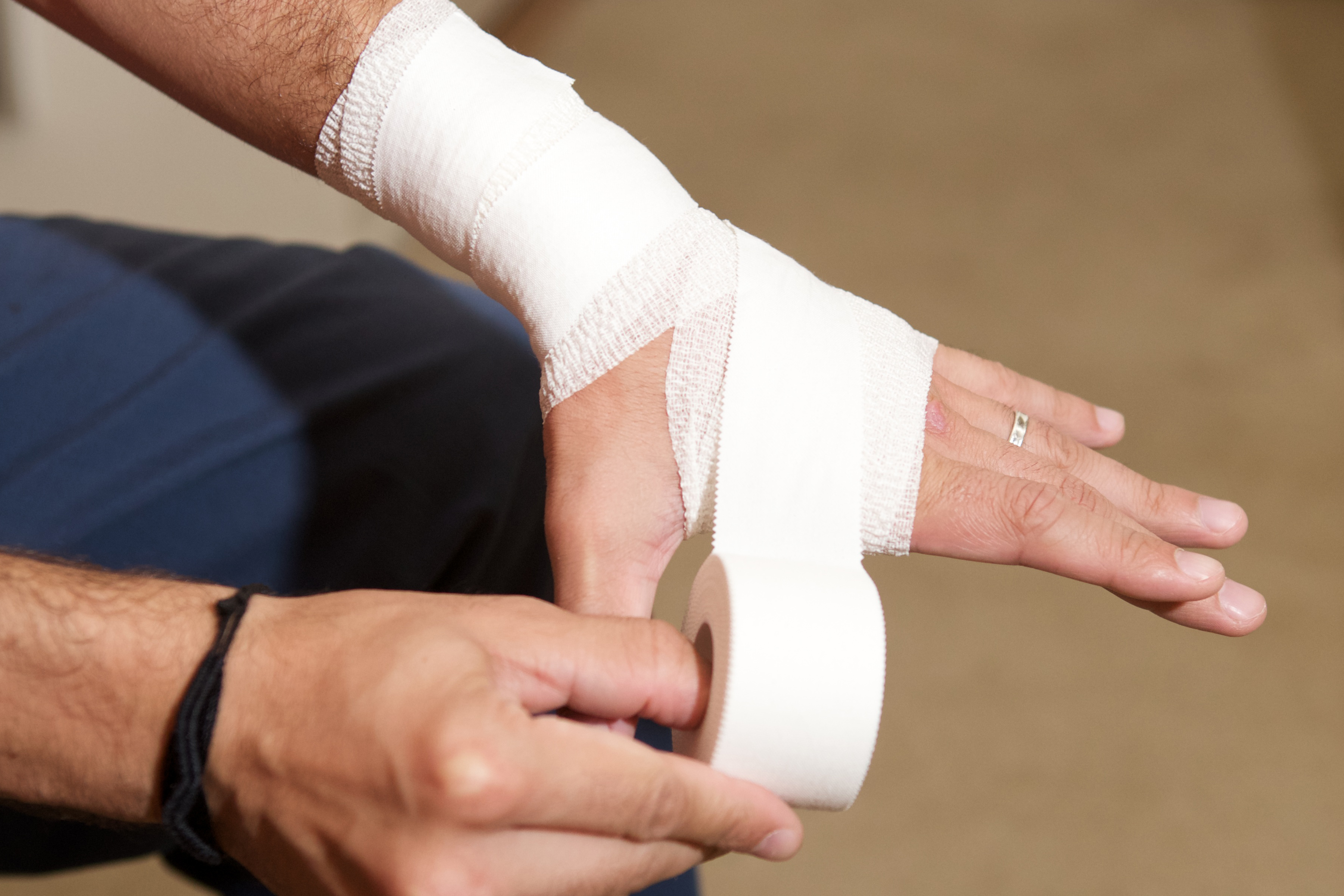 How to Wrap a Wrist With Athletic Tape | LIVESTRONG.COM