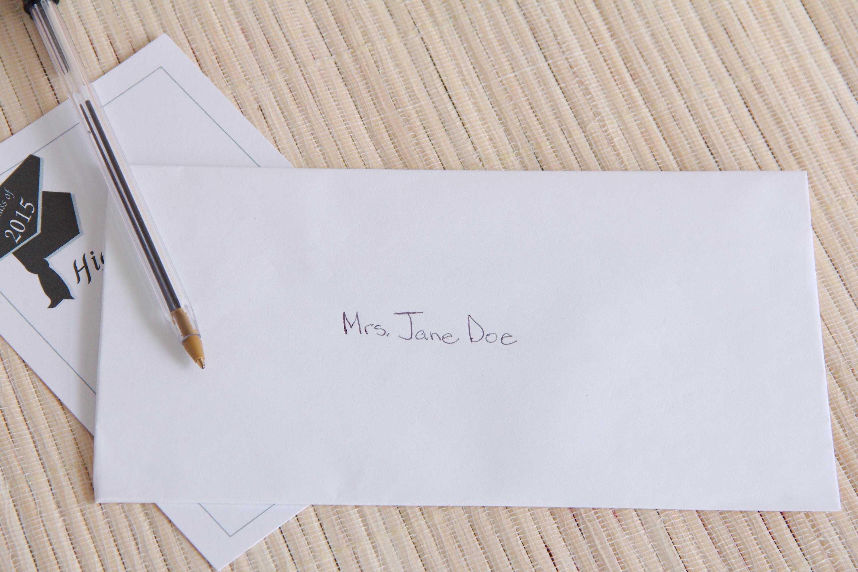 ba9fd110 6daa 4064 bba8 eba218741129 proper way to address graduation invitations our everyday life,Graduation Invitation Envelopes