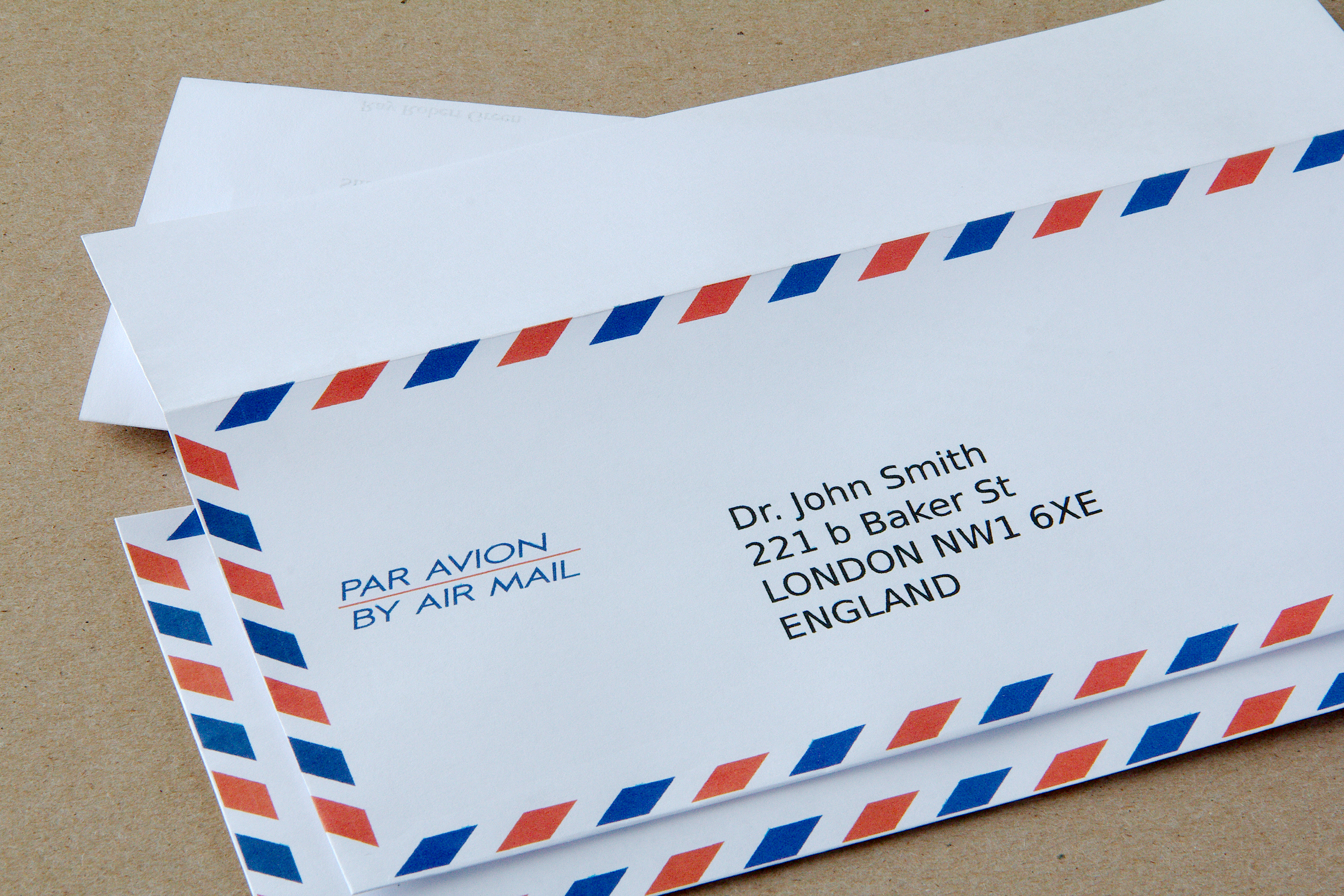 place the mail in an envelope you can put letters in envelopes designed for air mail with blue and red markings around the edges with the words air