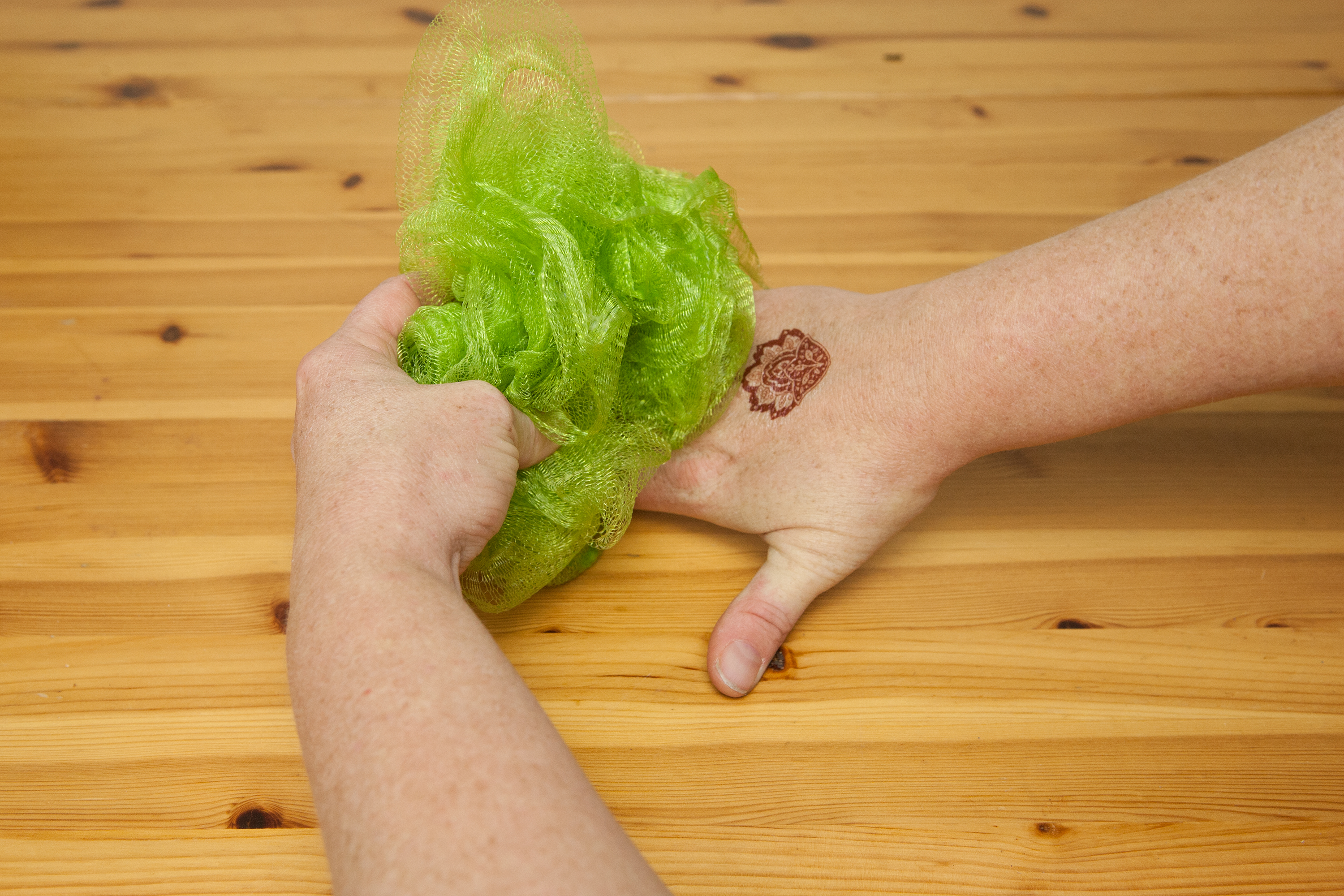 Rub the henna tattoo with a loofah during your daily shower. The use ...