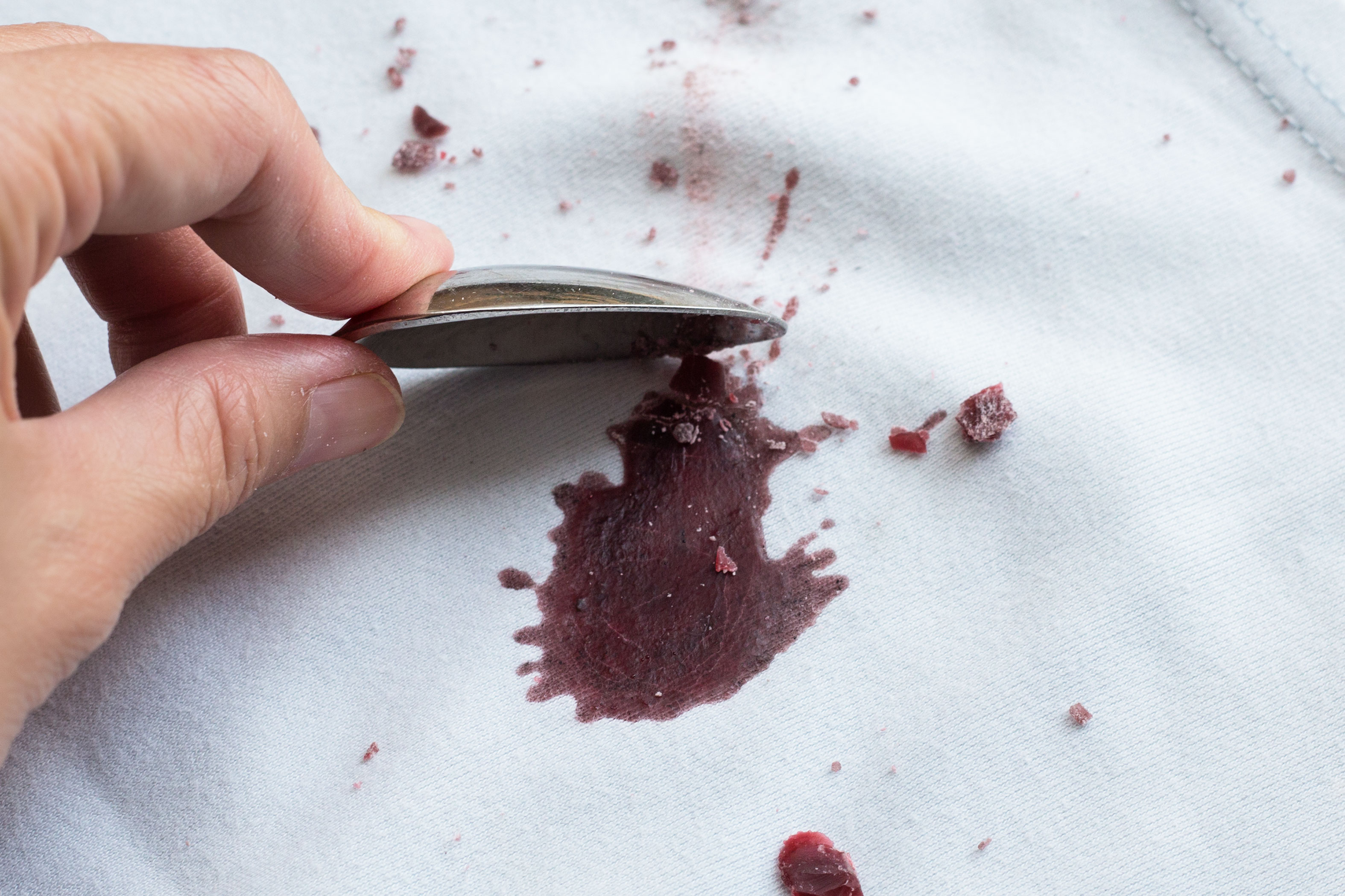 how to get candle wax stain out of clothes