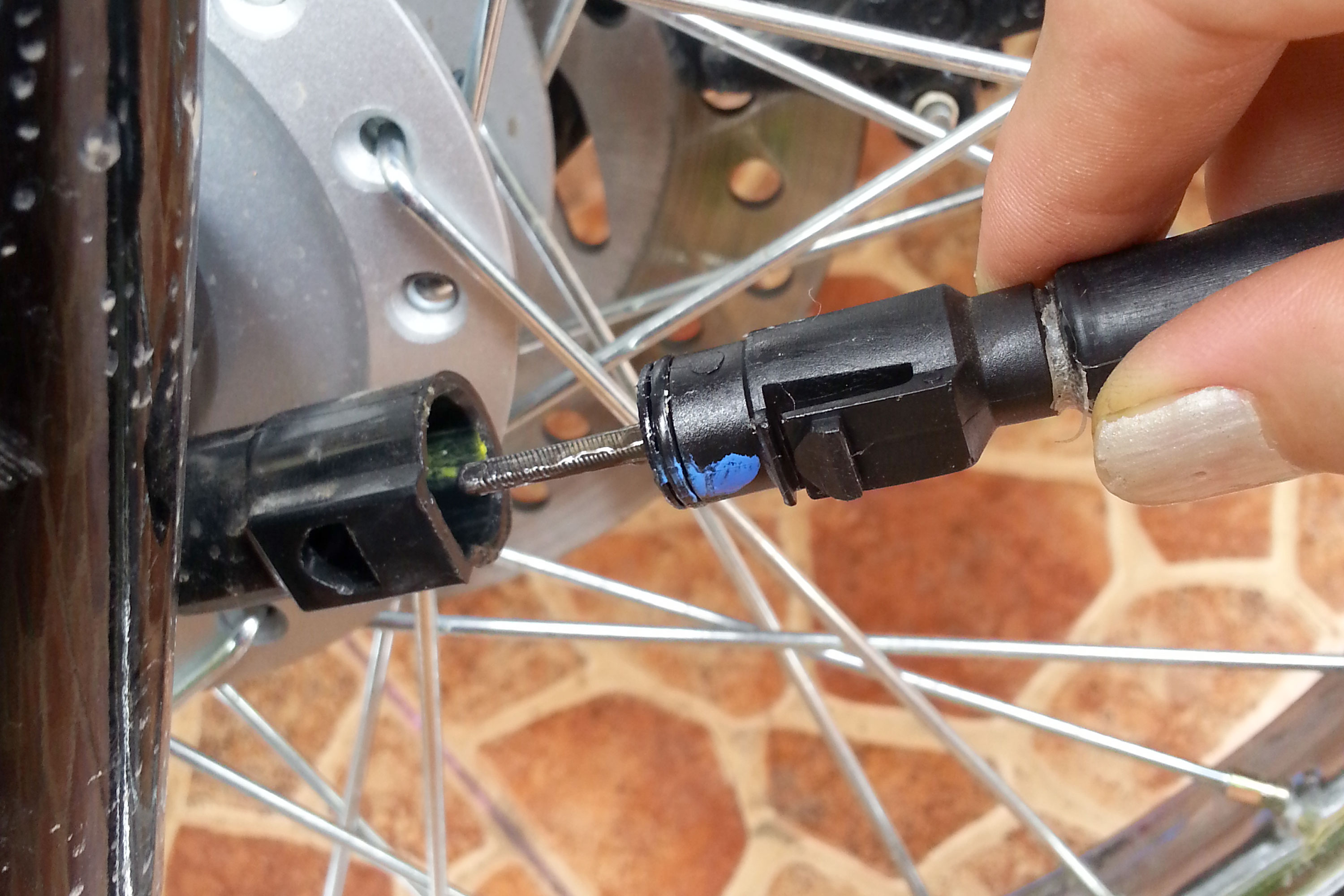 How To Repair A Motorcycles Speedometer Gone Outdoors Your Motorcycle Fuse Box Replacement Locate The Lower End Of Cable Where It Attaches At Front Wheel Hub Use Small Metric Wrench Loosen Fitting That Connects