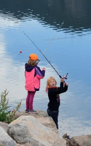 Fishing poles were given away to the first 600 kids at Quail Lake in Colorado Springs, June 6, 2015. Volunteers with Colorado Parks and Wildlife assembled the poles and instructed kids on how to use them. (Jerilee Bennett, Out There Colorado file)