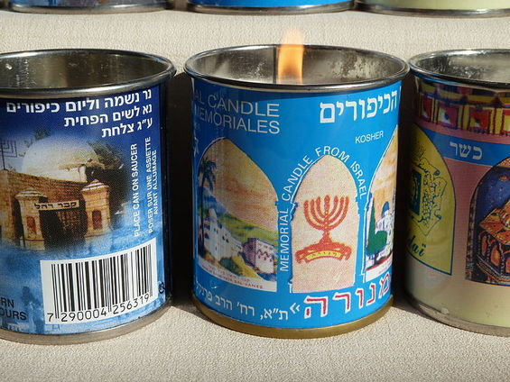 Why do we light Yahrtzeit candles? Where does the custom of lighting memorial candles for the dead come from, and when are we supposed to light them?