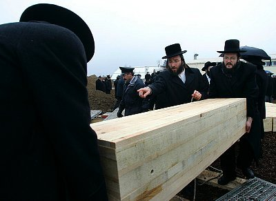 At Jewish funerals, why are the caskets closed?  Don't most funerals have open caskets?
