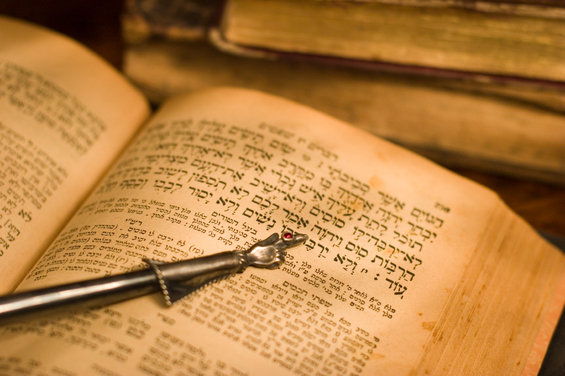 I'm interested in learning more about Judaism and would like to buy the Hebrew Scriptures, but I need something in English. Do you have any recommendations on what to buy?