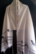 I have a tallit that is too long for me. Is there a good way to shorten it? Is that allowed?