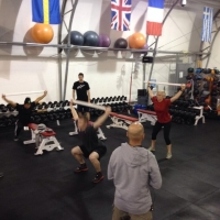 U.S. elite BMX riders demo workouts during a gym session