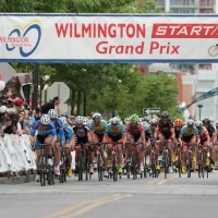 The mens peloton snakes through the streets of Wilmington