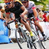 A rider from Optum p/b Kelly Benefit Strategies leads a rider around a turn
