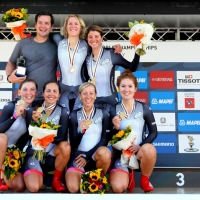 Carmen Small (2nd from left in front) and Evelyn Stevens (back row, right) show off their gold medals with their Specialized-lululemon teammates