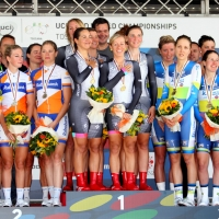 Carmen Small and Evelyn Stevens stand on the top step with their Specialized-lululemon squad