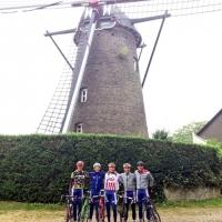 Geoffrey Curran, Justin Oien, Logan Owen, William Barta and Miguel Bryon near a windmill