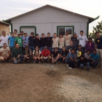 A larger group photo after the completion of the home building