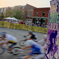 Riders speed past the crowds in Lake Bluff, Ill.