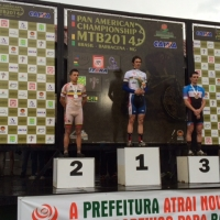 Stephen Ettinger stands on the top step at the 2014 Pan Am MTB Championships