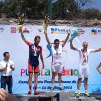 Joey Rosskopf salutes the crowd at the 2014 Pan Am Road Championships