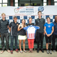 Press conference attendees pose with the coveted Stars-and-Stripes jersey