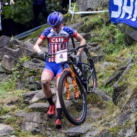 Haley Batten off her bike during the womens U23 cross country race at the UCI World Cup in Mont-Saint-Anne
