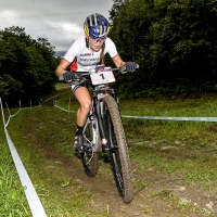 Kate Courtney all alone in front during the womens U23 cross country race at the UCI World Cup in Mont-Saint-Anne