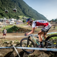 Kate Courtney rides to victory at the Val di Sole World Cup