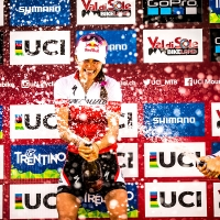 Kate Courtney sprays the champagne after claiming the 2017 World Cup title