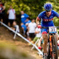 Lea Davison races to a 7th-place finish at the Val di Sole World Cup
