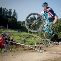 Peter Karinen gets some air during the U23 race at the Val di Sole World Cup