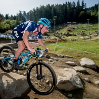 Peter Karinen rides in the U23 race at the Val di Sole World Cup