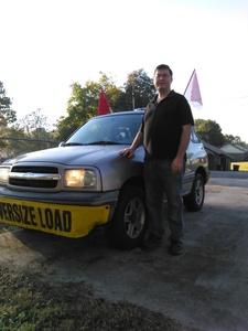 Matt with pilot car. image