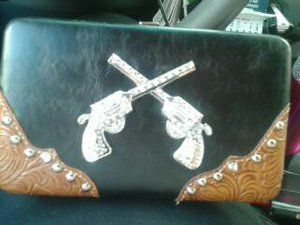 TWO PISTOLS BILLFOLD ON TX-LA