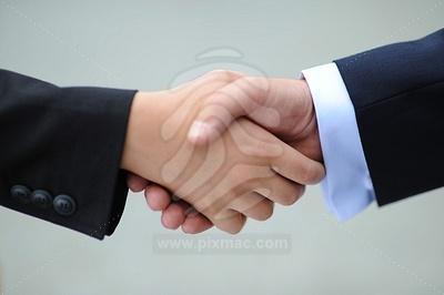 two-businessmen-shaking-hands-10.jpg
