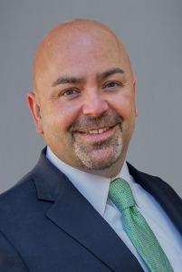 Kevin Greeley, Leader Bank