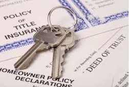 Who pays title insurance in Palm Beach County?