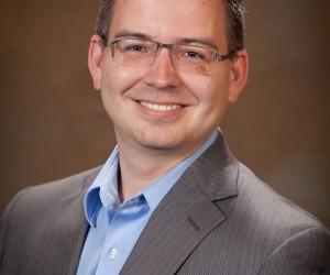 Travis Martinez, Broker