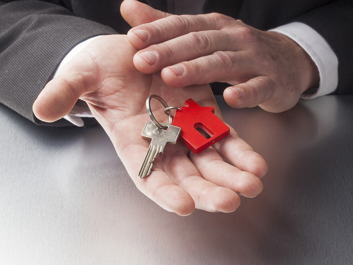 a pair of hands holding keys