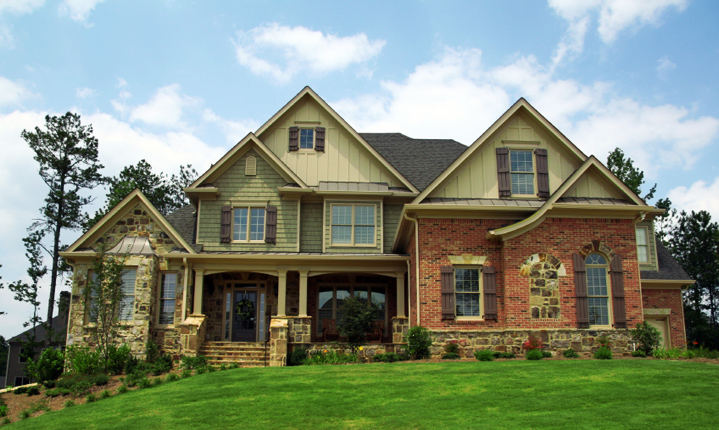 a two-story brown home