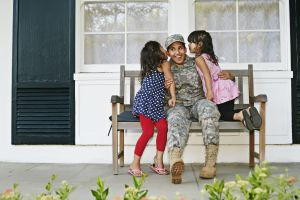 Military Mom in front of a House