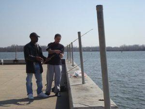 Fishermen convene at Pulaski Park on a sunny March afternoon.