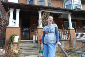 Anne Nielson in front of her home on North 12th Street in the Logan neighborhood.