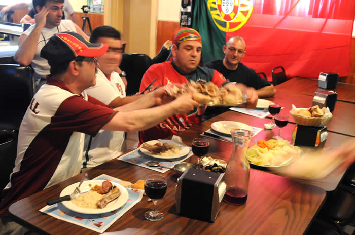 Friends gather at Cafe Liz' to watch soccer and eat Portuguese cuisine.