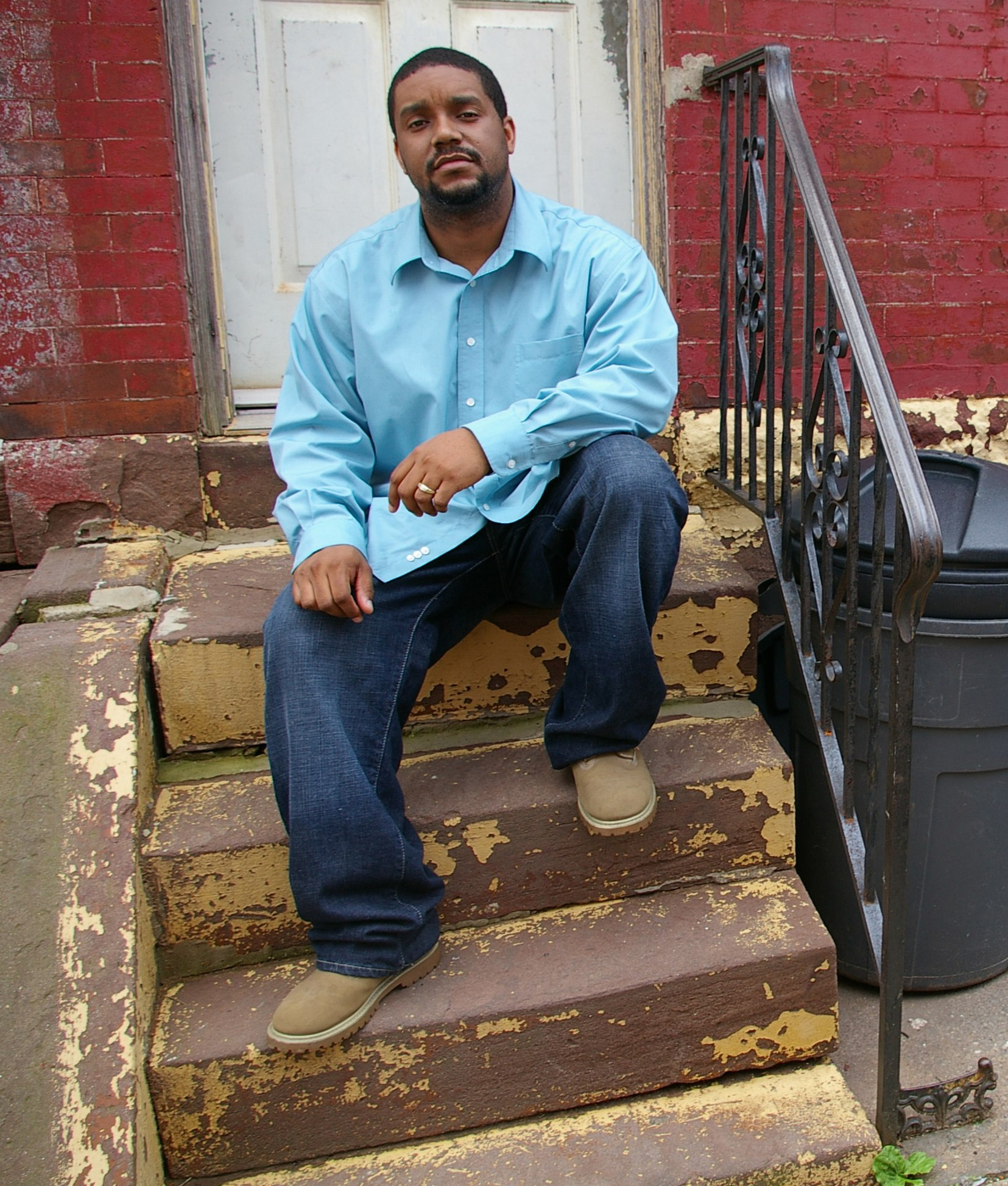 Donte sits on the stoop of his home in Strawberry Mansion.