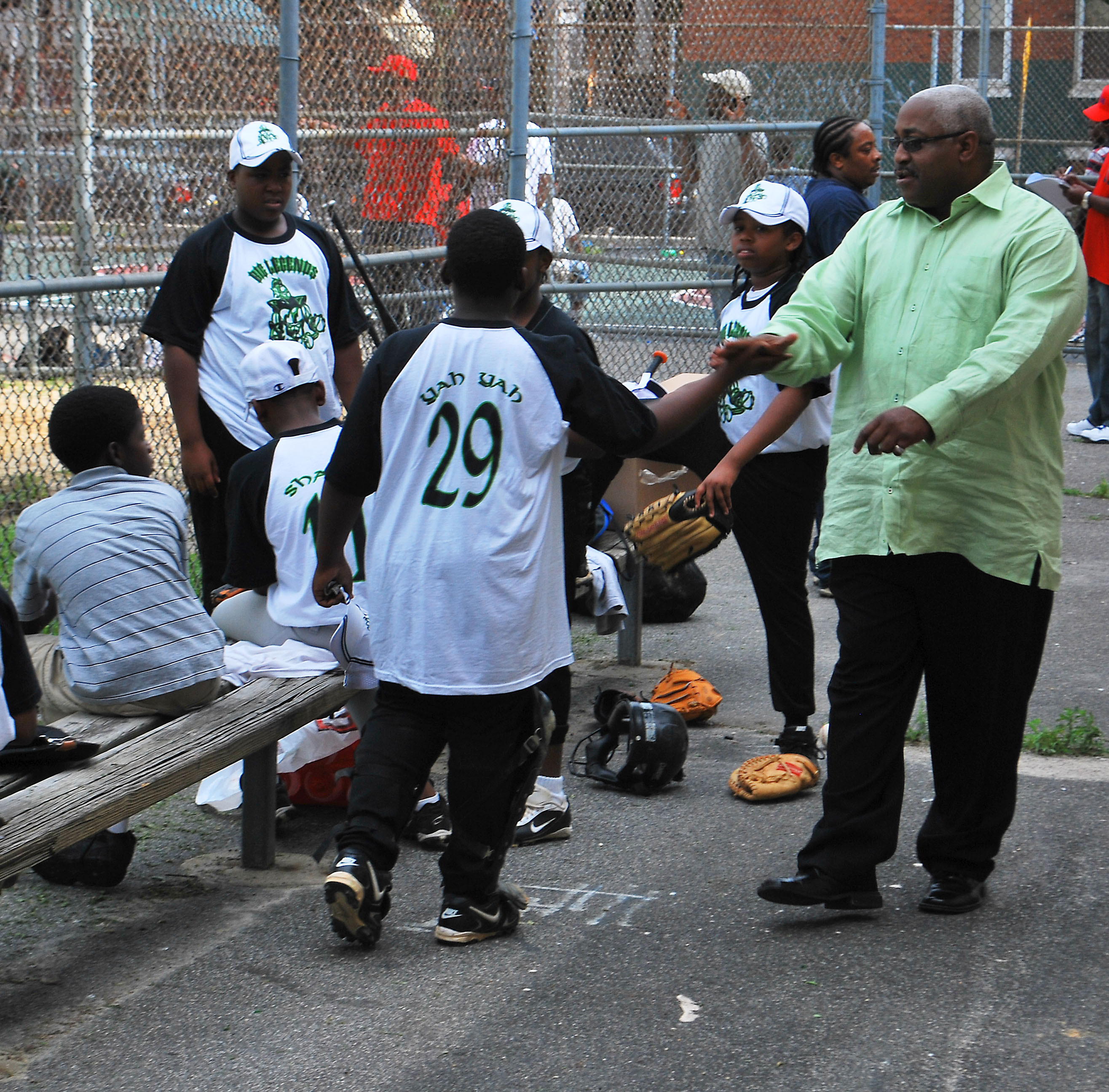 Derrick Ford greets Stawberry Mansion All-Stars before a game.